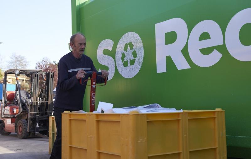 Wincanton Case Study - Man pushing paper bin